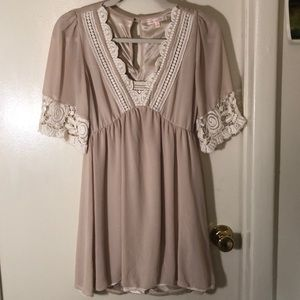 Beige dress with white trim